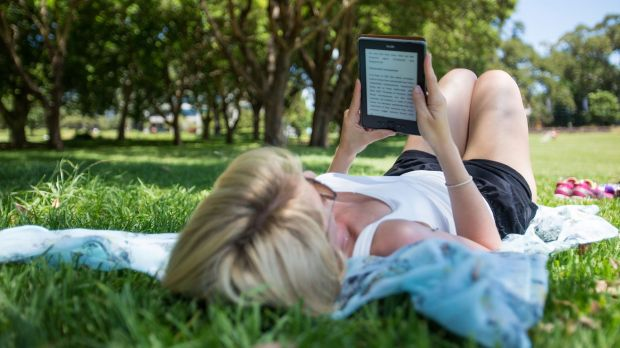 A woman beats the heat on the first day of summer, when Sydney temperatures hit 38 degrees.