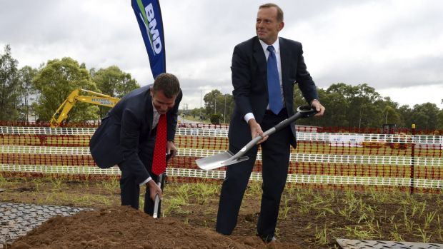 "Former prime minister Tony Abbott, pictured with NSW Premier Mike Baird, wished to be remembered as the ""infrastructure ..."