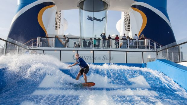 High-tech entertainment on the new cruise ships includes an iFly skydiving experience and a FlowRider surf machine.
