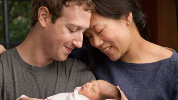 Mark Zuckerberg and his wife Priscilla Chan with their daughter Max in a picture they posted on Facebook this week ...