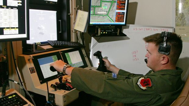 "Drone operators or ""cubicle warriors"" steer attacks on targets on the other side of the planet."