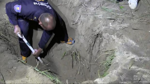 Wayne Schneider's body was found in a two-metre-deep grave in roadside bushes near a Chinese temple.
