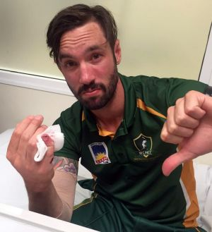 Ouch!: Jono Dean in hospital after dislocating his pinky finger in the regional Twenty20 final.