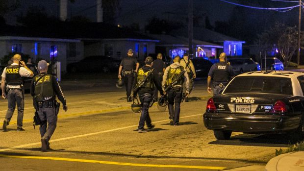 Authorities guard the perimeter near the location of the shooting in San Bernardino, on Wednesday.