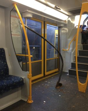 The metal bar that tore through the floor of the third carriage and hit its ceiling.