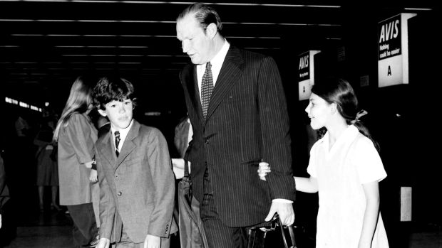Kerry Packer is greeted at Sydney Airport by his children James and Gretel in 1977.