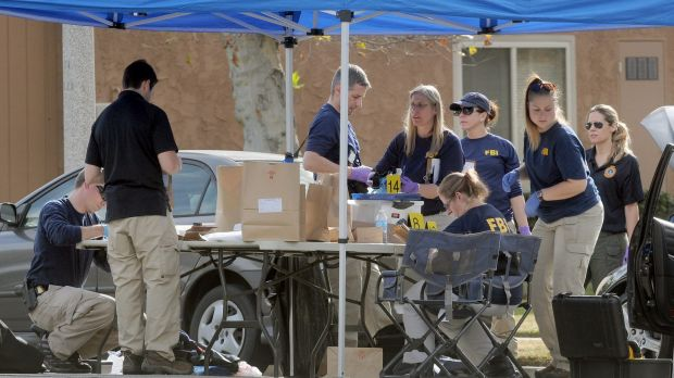 FBI officials continue pulling evidence from a car at the home of the San Bernardino mass shooting suspects.