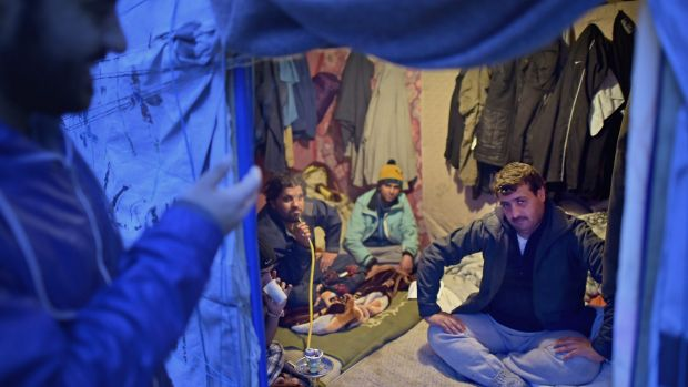 Migrants in a Calais camp are enduring a long, cold winter in makeshift shelters.