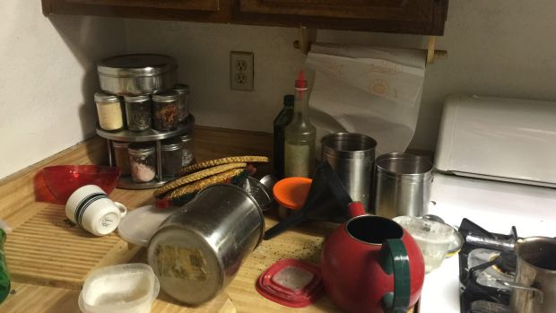 Pots and pans were strewn over the kitchen.