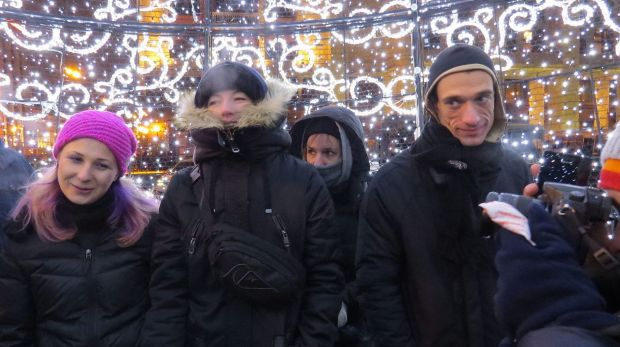 Pavlensky (right) during a protest in Moscow in 2014. The artist has been daring authorities to punish him.