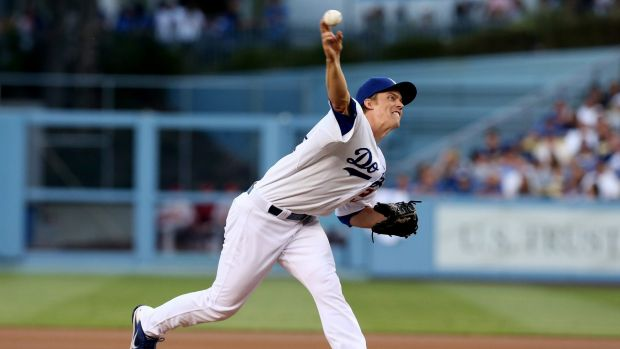 Moving on: Zack Greinke throws a pitch for the LA Dodgers.