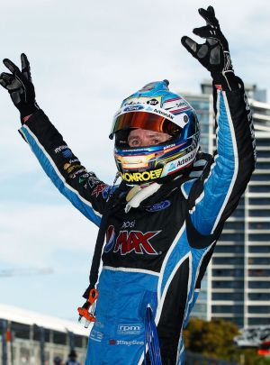 Mark Winterbottom celebrates after claiming his maiden V8 title.