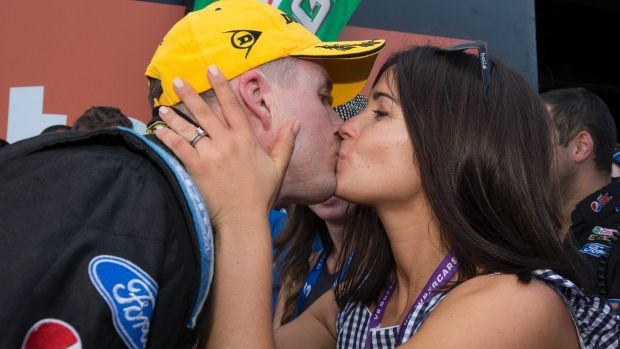Mark Winterbottom is kissed by his wife Renee after he  clinched the 2015 V8 Supercars Championship.