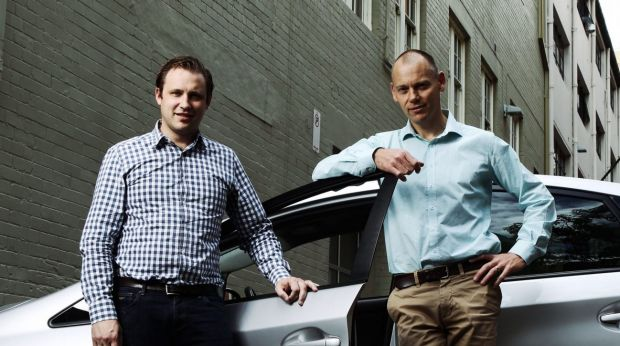 David Rohrsheim, CEO Uber Australia, and SocietyOne CEO Matt Symons outside Uber's offices in Sydney.