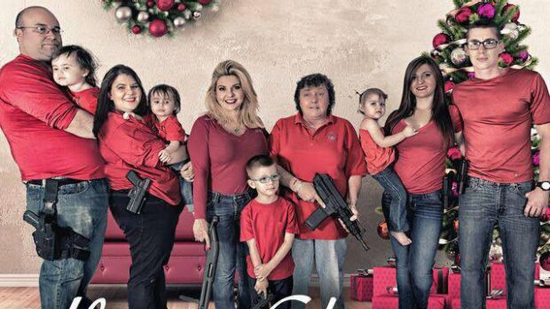 Nevada Republican Michele Fiore, third adult from left, as she appears in her family Christmas card featuring guns.
