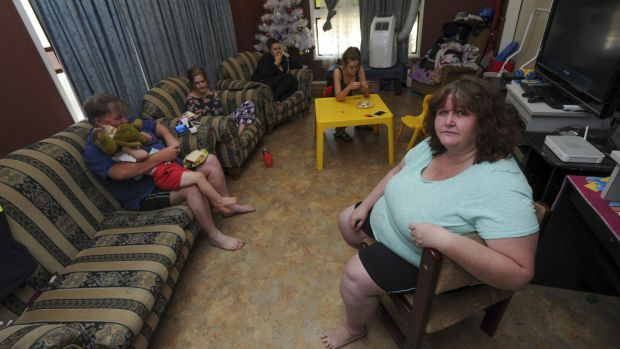 The Muller family eat in the lounge room of their ACT government home in Stirling because one daughter sleeps in the ...