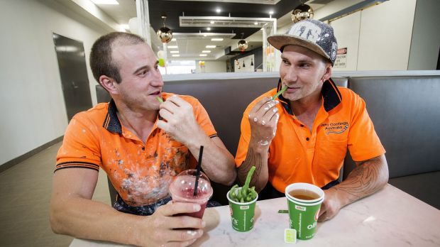 Construction workers Jeremy Krojs (left) and Darryl Piotrowski eating green beans and drinking a smoothie and green tea ...