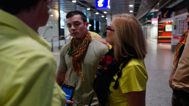 Julia Dyball and Michele Harding greet anti-Islamic State fighter Ashley Dyball who  returned to Melbourne on Monday 7 ...
