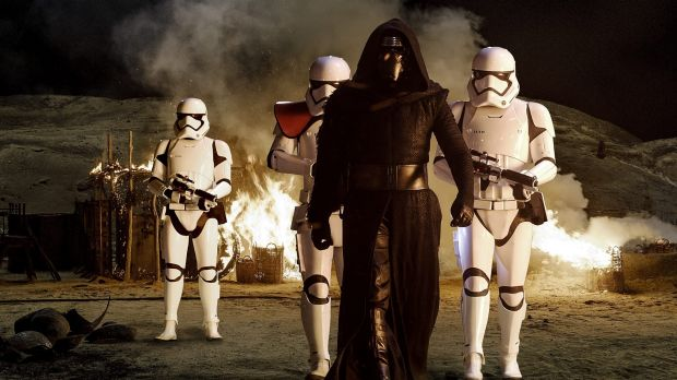 Kylo Ren (Adam Driver) with Stormtroopers in <i>Star Wars: The Force Awakens</i>.