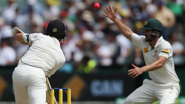 Historic: New Zealand's Kane Williamson hits the pink ball past Australia's Joe Burns during their day-night Test in ...