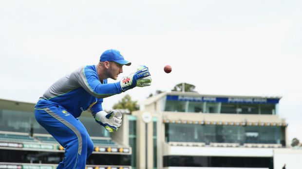 Venue fight: Australian wicketkeeper Peter Nevill takes the ball during an Australian nets session at Blundstone Arena.