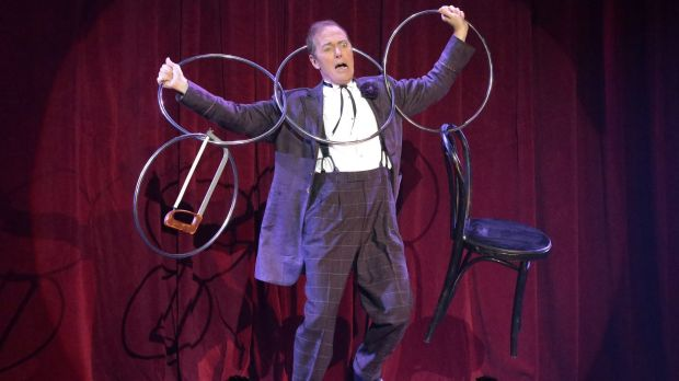 The Eccentric, aka Charlie Frye, performs with the linking rings.