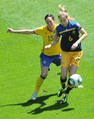 Sweden's Therese Sjogran and Ellyse Perry vie for the ball during the quarter-final soccer match of the FIFA Women's ...