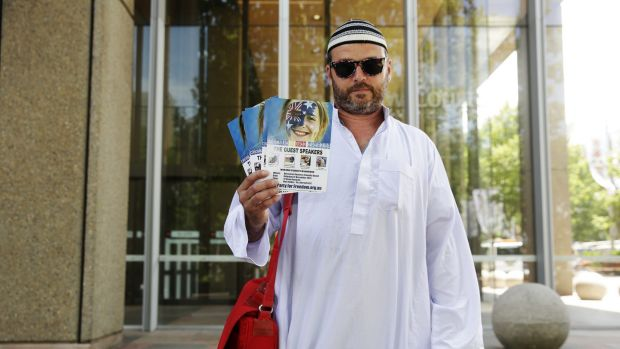 Nick Folkes leaves court dressed in mock Islamic outfit after appealing against a Federal Court injunction to stop the ...