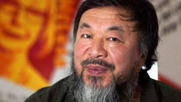 Chinese artist and activist Ai Weiwei in his room of portraits of Australian human rights activists, part of the Andy ...