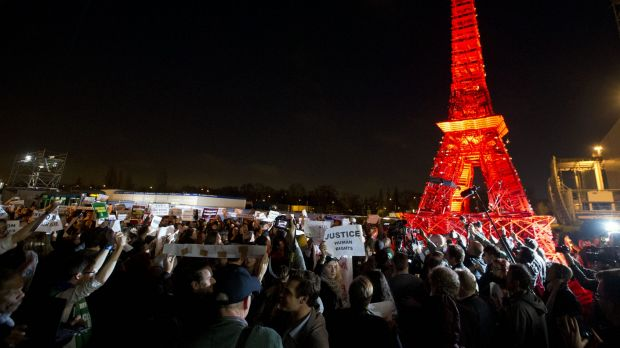 Activists gather next to a mini Eiffel Tower after a sit-in protest to denounce a draft text released at the climate ...