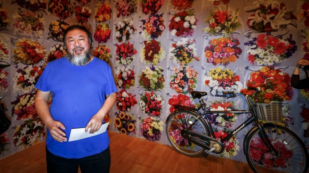 Ai Weiwei in front of one of his new works, With Flowers, 2015, at the National Gallery of Victoria for the Andy ...