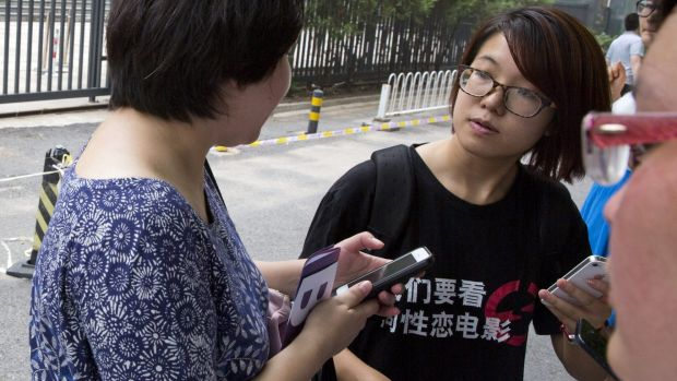 Rights' activist Wei Tingting outside a court where the first case in China involving so-called conversion therapy was ...