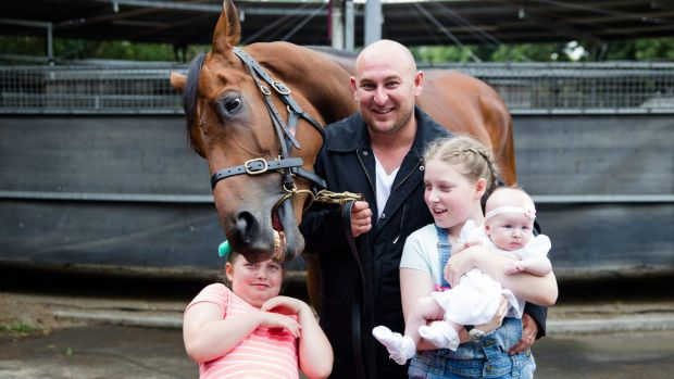 Wayne Webster with daughters, Georgia, 9, Jessica, 11, and Frankie, four months, and, of course, Happy Clapper.