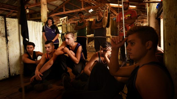 The Merriman Shearing School's students watch a demonstration near the end of the 13-week course.