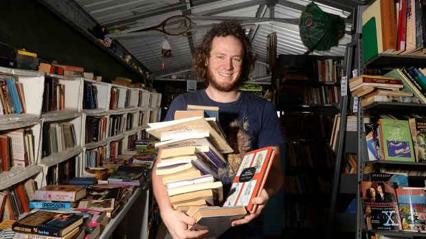 Yarran Jenkins uses an honesty payment system at his Bardon book shop, Logical Unsanity.