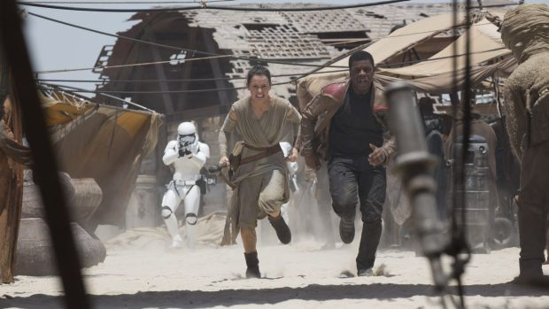 Hasty retreat ... Rey (Daisy Ridley) and Finn (John Boyega) in The Force Awakens.