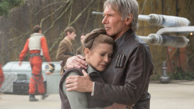 Wearing well ... Harrison Ford in THAT jacket comforts Leia (Carrie Fisher) in Star Wars: The Force Awakens.