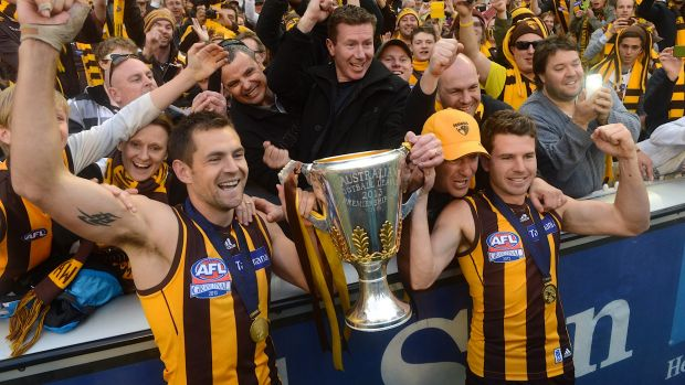 Simpkin (right) with Hawk skipper Luke Hodge after the 2013 grand final.