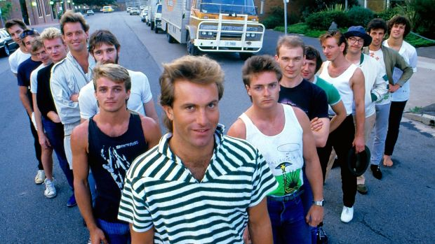 The crew of Australian Crawl, fronted by James Reyne, along with the band's roadies in 1984.
