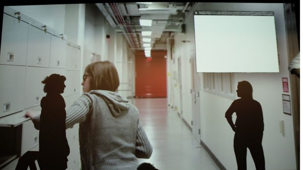Hannah Matthews and Annika Kristensen in front of a video that plays during The Biography of Things.