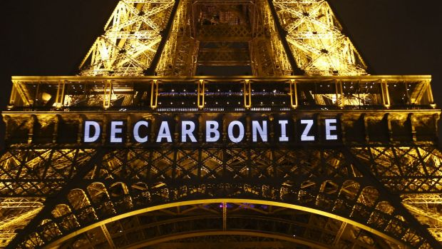 """The slogan """"DECARBONIZE"""" is projected on the Eiffel Tower as part of the COP21, United Nations Climate Change Conference ..."""