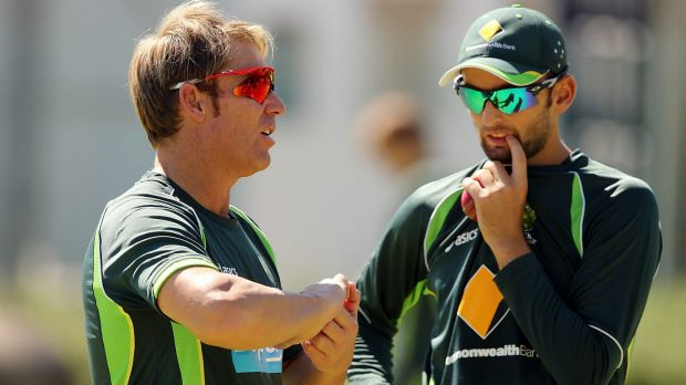 Shane Warne speaks to Nathan Lyon during an Australian nets session in 2014.