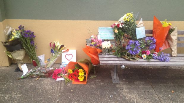 Students from Strathfield South Public School left flowers and notes at the bus stop where teacher Brian Liston died.