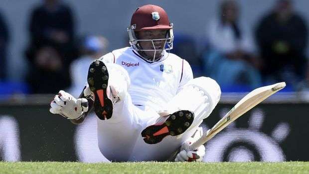 Down and out: West Indies fast bowler Jerome Taylor takes a tumble during the last rites at Hobart on Saturday.