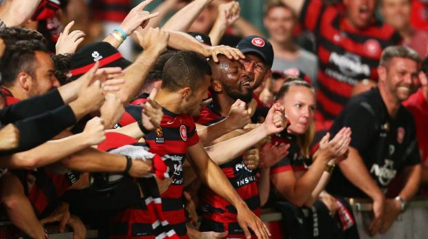 Quest for respect: Romeo Castelen of the Wanderers celebrates with teammates and fans.