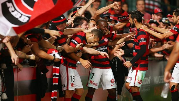 Engagement: Wanderers players interact with their fans.