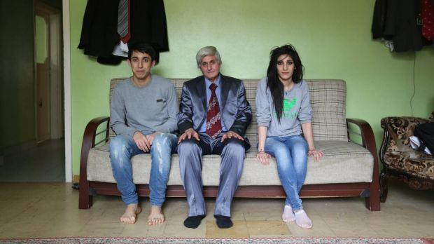 The man with his children, who were inside their house when it was hit by a missile, killing their mother and sister.