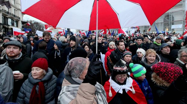 Tens of thousands of Poles angered by an ongoing constitutional conflict march in Warsaw, Poland, last month.