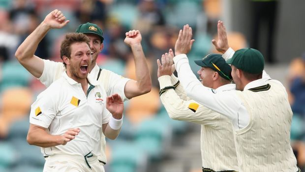 Happy days:  James Pattinson  celebrates dismissing Jermaine Blackwood during day three of the first Test between ...