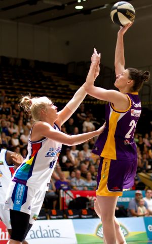 Capitals forward Abby Bishop applies some defensive pressure against the Melbourne Boomers.